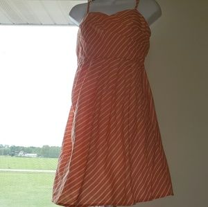 A. Buyer size 9 peach and white dress